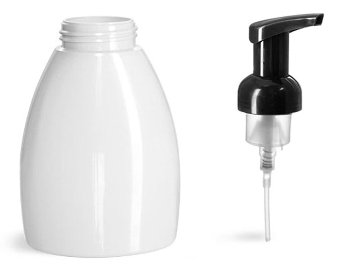 3 empty plastic white bottles with black